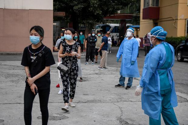 Coronavirus' return to Beijing disrupts life and rattles nerves 1