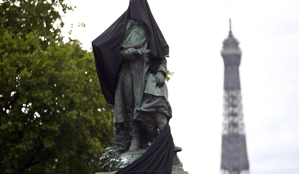 Paris protesters cloak colonial-era statue with black cloth 1