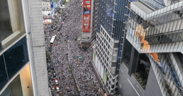 Hong Kong Activists March on First Anniversary of Protests 1