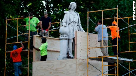Baltimore protesters toppled a Christopher Columbus statue and threw it in a harbor 1