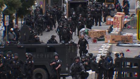 Seattle protesters struck by car; suspect in custody, police say 1