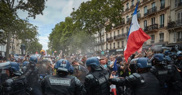 Bastille Day Battle: Antifa and Protesters Clash With Police in Paris 1