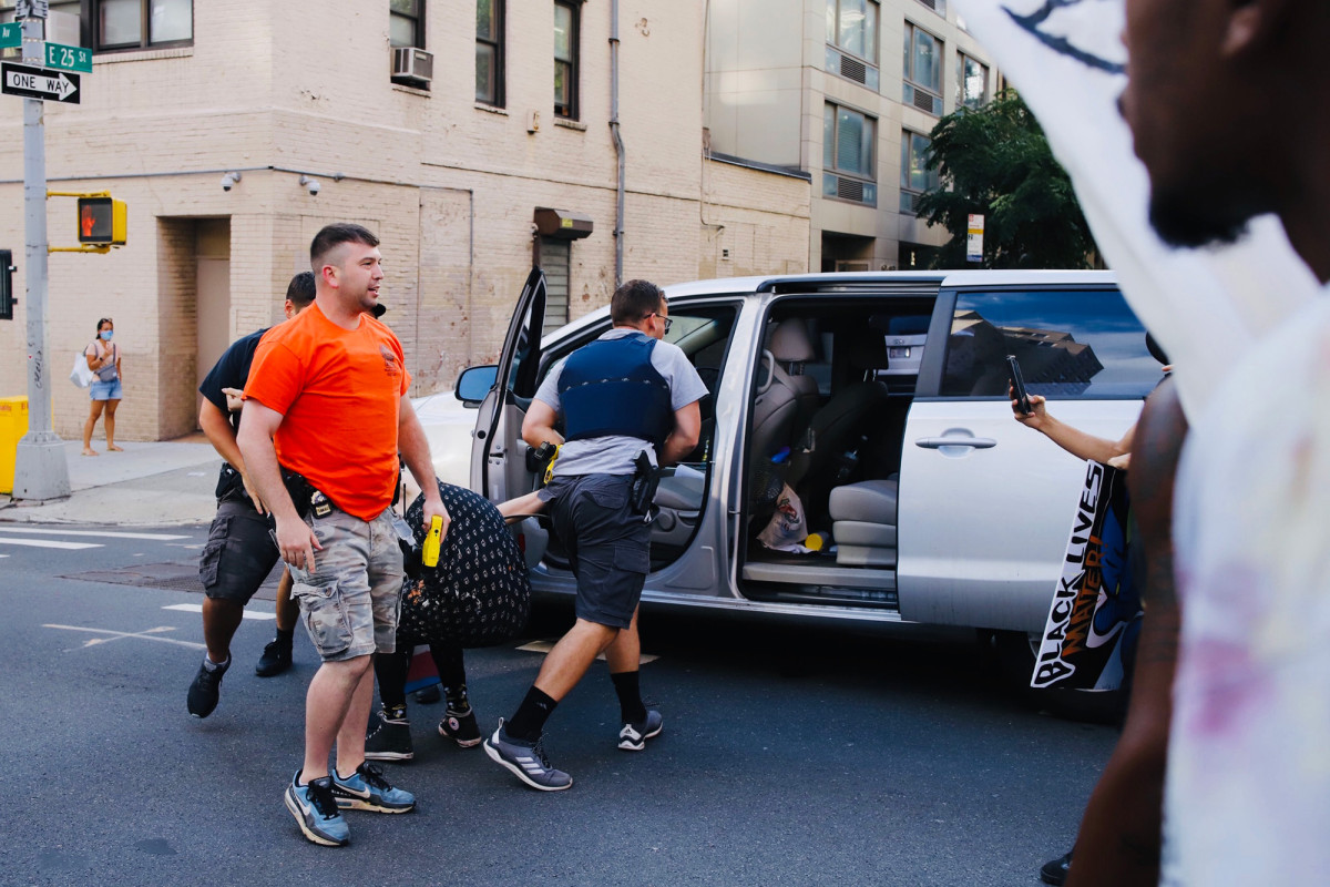 Manhattan protester busted by NYPD, loaded into unmarked minivan 1
