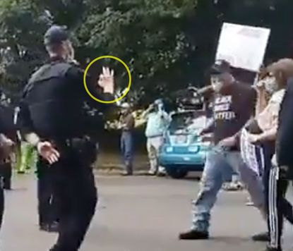Oregon state police investigating video of officer allegedly flashing white power sign at protest 1