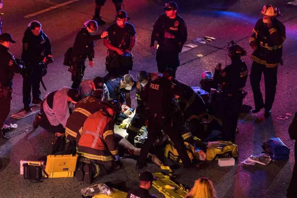 1 of 2 protesters hit by driver on Seattle freeway dies 1