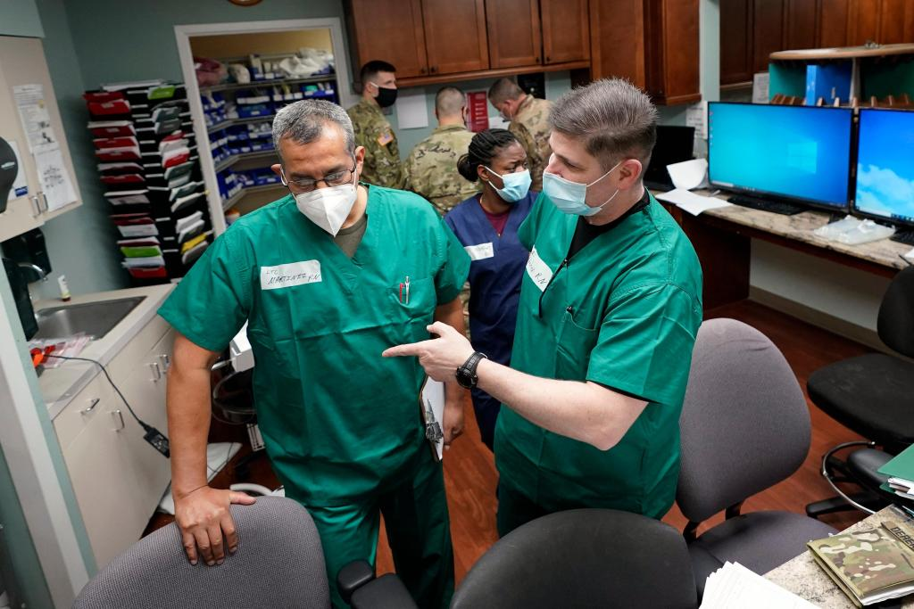 As COVID-19 surges in some U.S. states, emergency rooms swamped 1