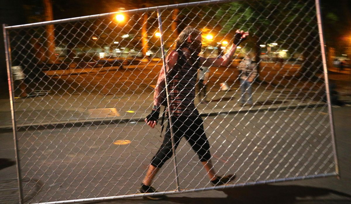 Fires set, fences moved: Police call Portland protest a riot 1