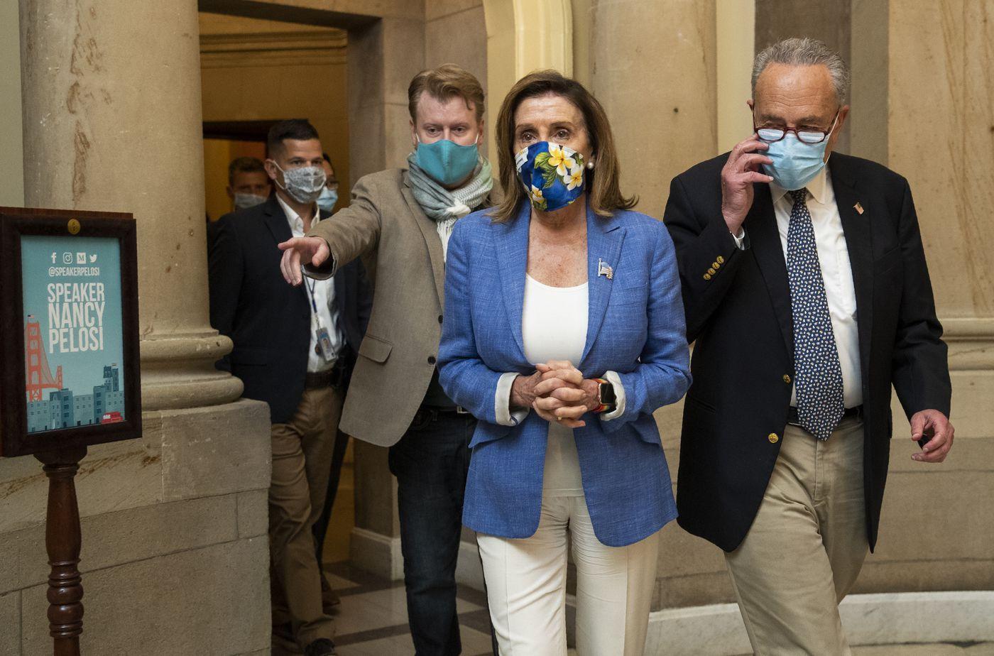 Upbeat Schumer, Pelosi report progress in coronavirus relief talks 1