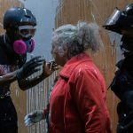 Elderly Portland woman confronts protesters, gets splattered with paint 9