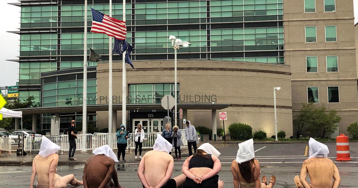 Nearly naked demonstrators protest Daniel Prude's killing 1