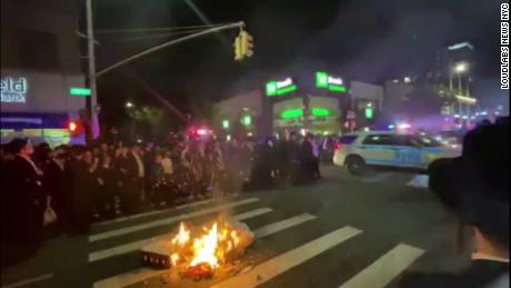 Protester taken into custody for inciting a riot during Orthodox Jewish protests against New York's Covid-19 restrictions 1