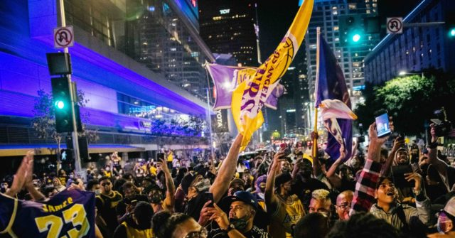 WATCH: 'Mostly Peaceful' Lakers Fans Party Outside Staples Center; Few Masks, LAPD Car Attacked 1