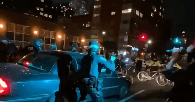 Watch: Car Drives into Line of NYPD Cops During Protest, At Least One Officer Wounded 1