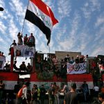 Thousands rally in Iraq to mark one year of protests 9