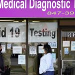 US sets coronavirus infection record; deaths near 224,000 12