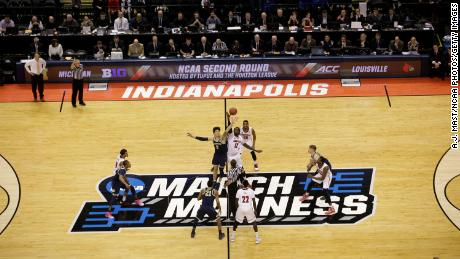 College basketball season tips off during coronavirus surge, with March Madness the ultimate goal 1