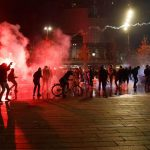 Protesters clash with police at Paris protest against police violence 5
