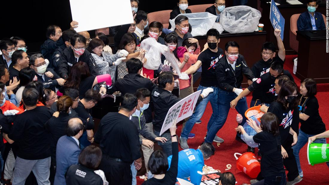 Taiwan lawmakers throw pig guts in protest over meat imports 1