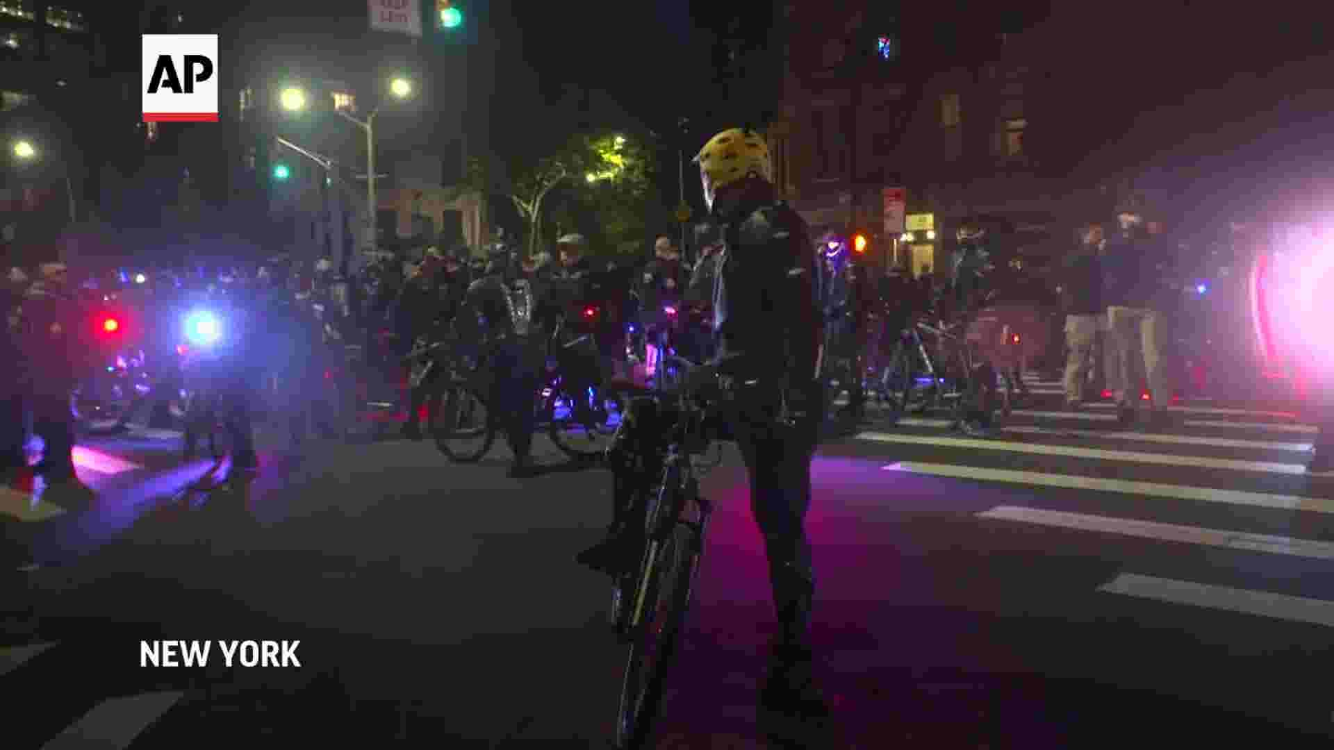Arrests after protesters set fires in NYC 1