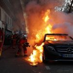 Paris police fire tear gas to disperse protesters who set bank on fire 7