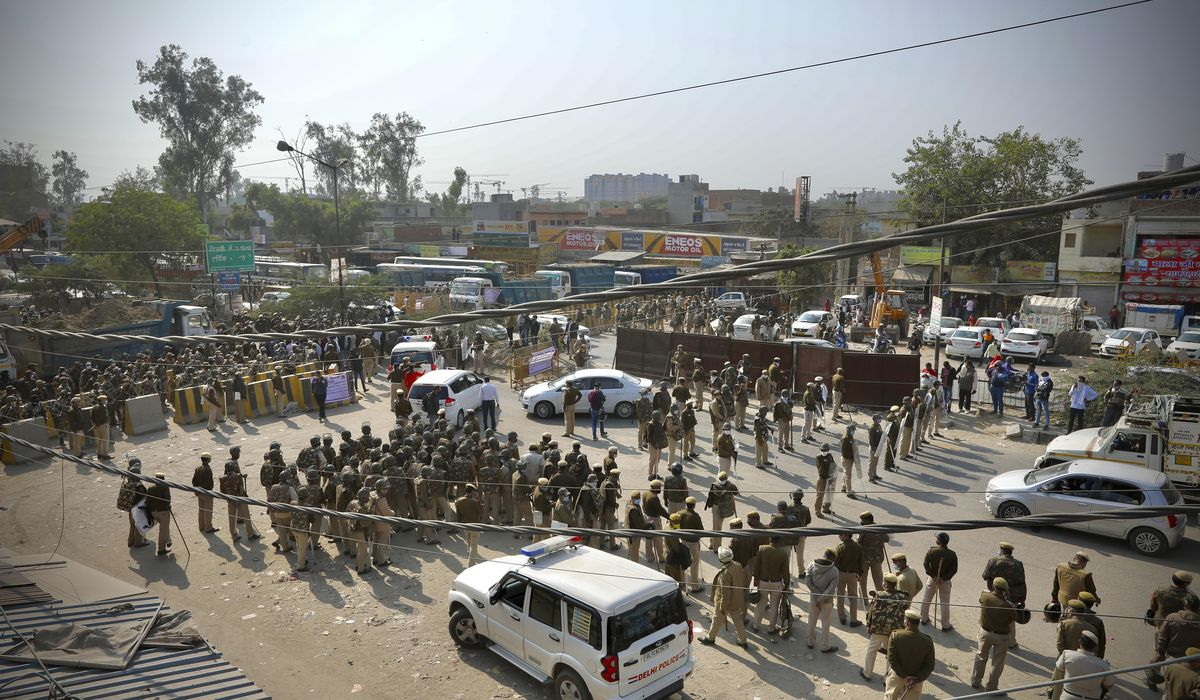Angry farmers in India clash with police to protest new laws 1