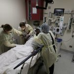 Hospitals face tough choices as ICUs fill up with COVID-19 patients 8