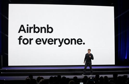 Airbnb shares open at $146 in long-awaited IPO 1