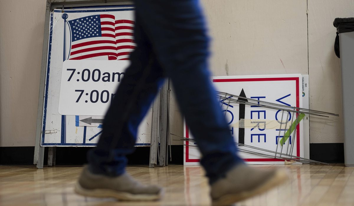 The Latest: Polls open for key Senate runoffs in Georgia 1