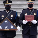 AP sources: Feds pinpoint suspect in officer's riot death 11