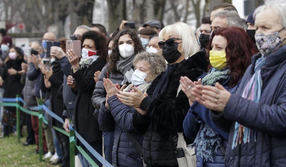 With heavy hearts, Italians mark year of COVID-19 outbreak 1