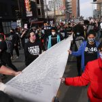 Protesters gather in Minneapolis on eve of George Floyd murder trial 1