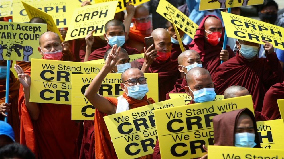 Defying deadly crackdown, crowds again protest Myanmar coup 1