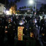LA police battle protesters as cops clear tent city in local park 8