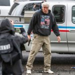 No charges for man who drew gun at dueling Oregon protests; four others arrested 7