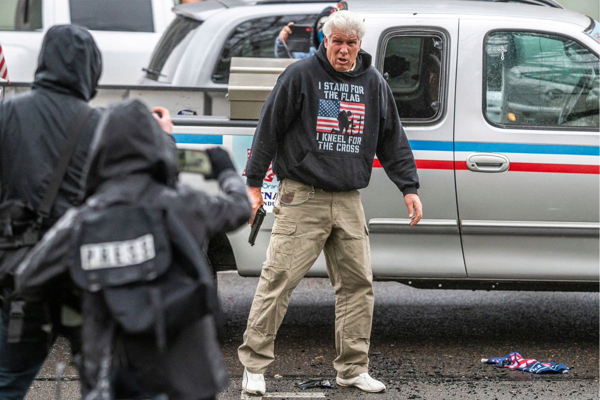 No charges for man who drew gun at dueling Oregon protests; four others arrested 1