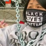 Protester chains herself to courthouse fence during Derek Chauvin trial 8