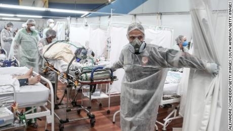 Overstretched health workers describe battling Brazil's worst Covid-19 wave yet 1