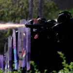 Thai police use tear gas, rubber bullets to break up protest 8