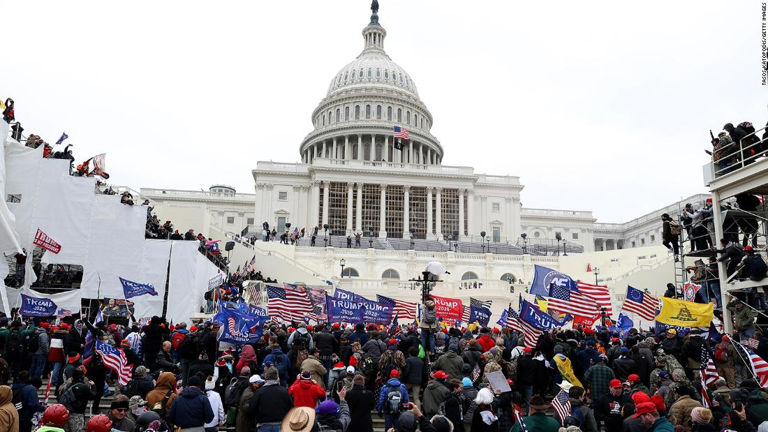 DEA agent says he was wrongly fired for being at Capitol riot 1