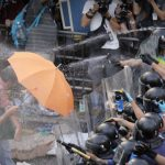 Pro-democracy protestors in Hong Kong defy calls to disperse 5