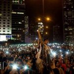 Protests grow amid celebrations in Hong Kong 7