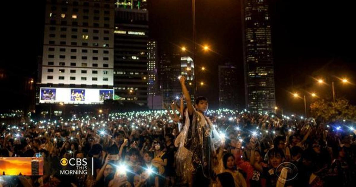 Protests grow amid celebrations in Hong Kong 1