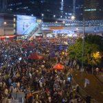 MoneyWatch: Hong Kong protests impact banks; Microsoft reveals Windows 10 3