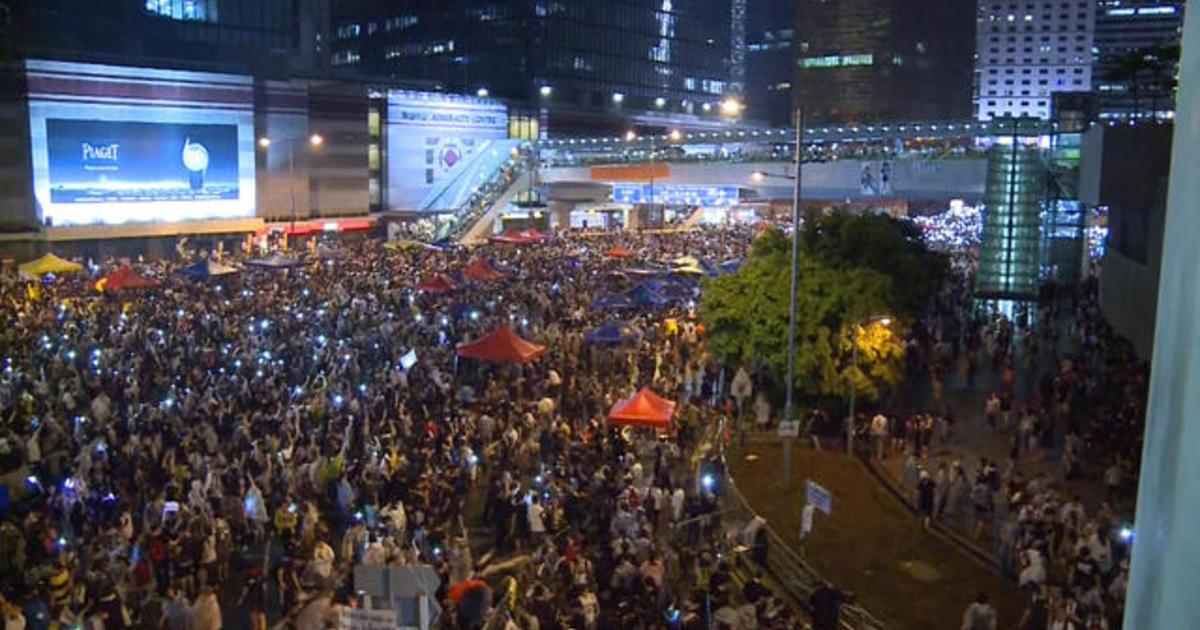 MoneyWatch: Hong Kong protests impact banks; Microsoft reveals Windows 10 1