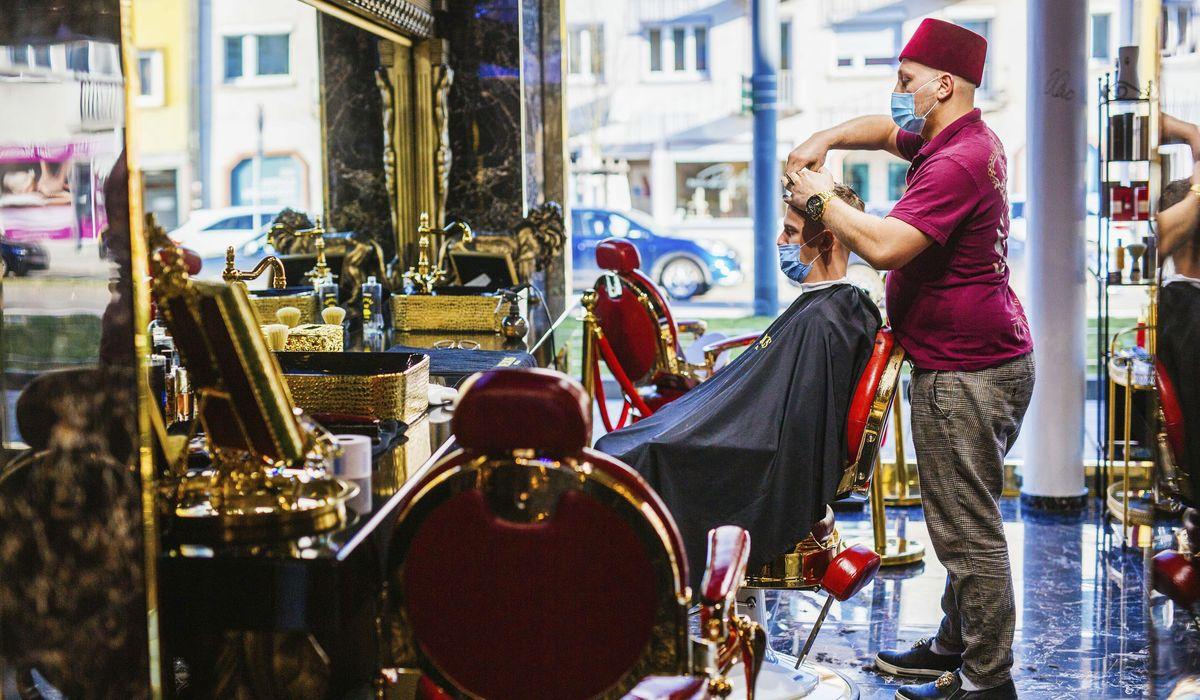 Germany reopens hairdressers, considers way ahead on virus 1