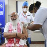 India giving COVID-19 vaccines to more people as cases rise 8