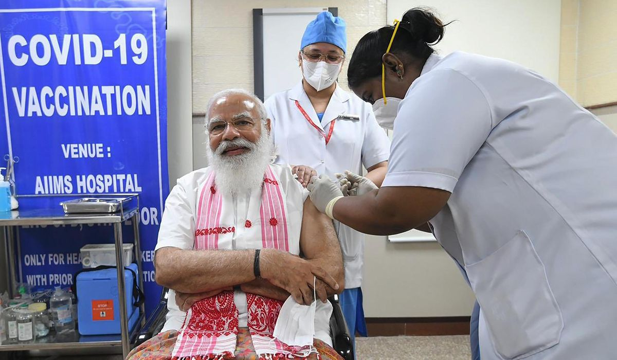 India giving COVID-19 vaccines to more people as cases rise 1
