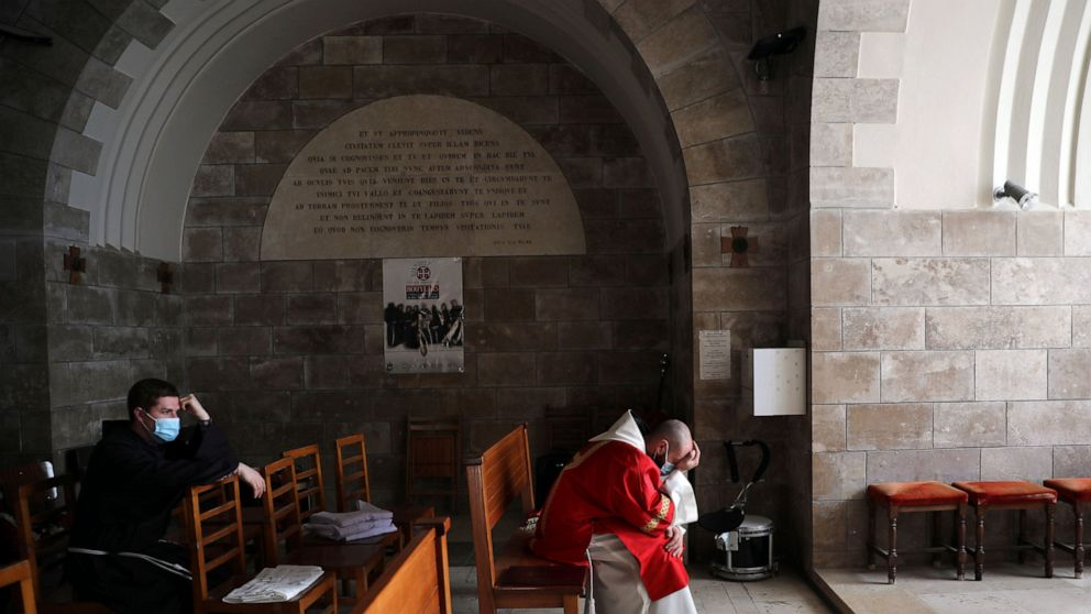 Christians mark Good Friday as some holy sites reopen 1