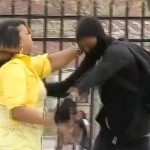 Angry mom grabs son off street amid Baltimore riot 4