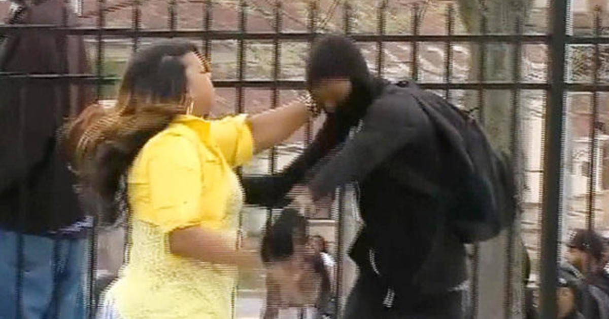 Angry mom grabs son off street amid Baltimore riot 1